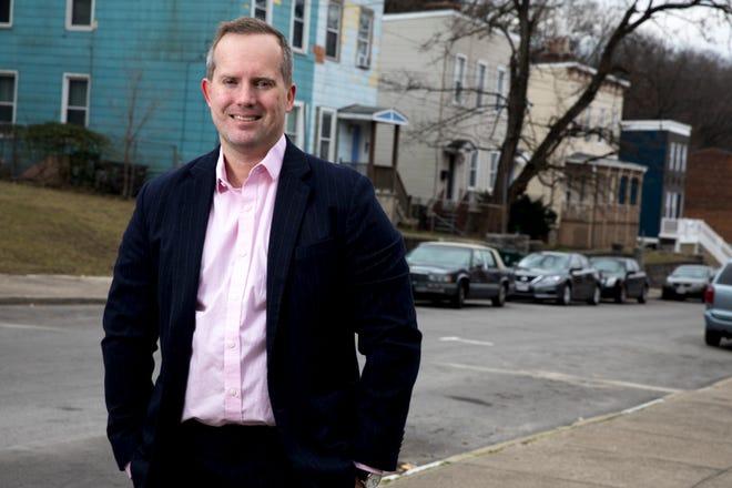 Mayoral candidate Adam Koehler, Cincinnati native and entrepreneur, stands near his residence in Mount Auburn on Saturday, Jan. 9, 2021.