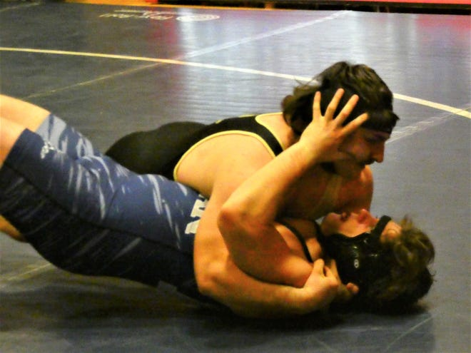 River View junior Michael Wagner nears a pin of Morgan's Landen Pettet at 220 pounds Saturday during the Licking Valley Invitational.