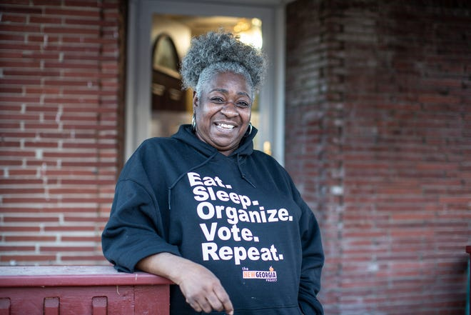 Zinnia Patcas who just returned home from canvassing for the Georgia run-off election poses for a photo at her home in Detroit, Mich., on Jan. 8, 2021.