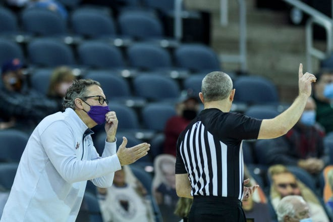 University of Evansville Head Coach Todd Lickliter argues with a referee about back-to-back foul calls, Saturday, Jan. 9, 2021.