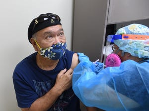 Maina resident Victor Jesus, 69, receives the Moderna COVID-19 vaccine at Southern Region Community Health Center in Inarajan, Jan. 9, 2021.