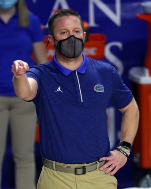 Florida Gators head coach Mike White against the Kentucky Wildcats during the first half at Billy Donovan Court at Exactech Arena in Gainesville, Florida, on Saturday, Jan. 9, 2021.