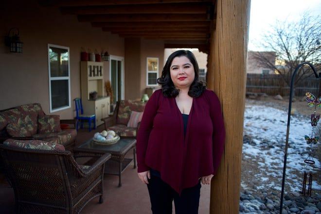 Alexandra Romero has gone back to school for a nursing degree. Here she is in her backyard in Santa Fe.