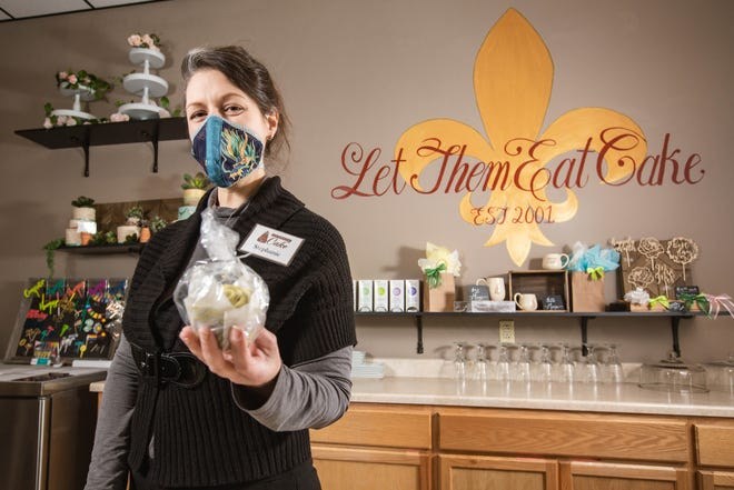 Stephanie Baumann, owner of Let Them Eat Cake on University Avenue in Las Cruces, shows one of the cake shop's offerings on Saturday, Jan 9, 2021. The business' physical location will open through Jan. 30 and is then transitioning online.