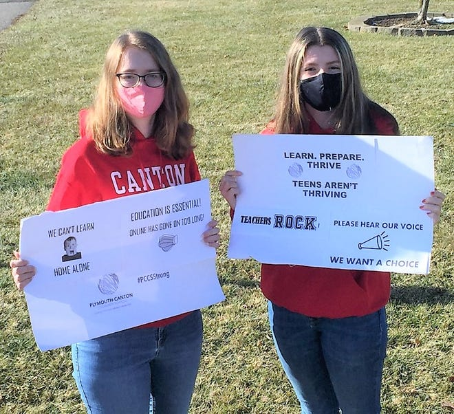 Sisters Ashley (left) and Katie Temple, students at Canton High School, have organized a meet-up set for Tuesday at the Plymouth-Canton Community Schools office in Plymouth.