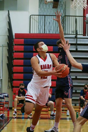 All masked up, Lebanon High center Isaiah Rodriguez goes up for two of his 19 points during the Cedars' dramatic 58-57 come-from-behind win over Conestoga Valley Friday night.