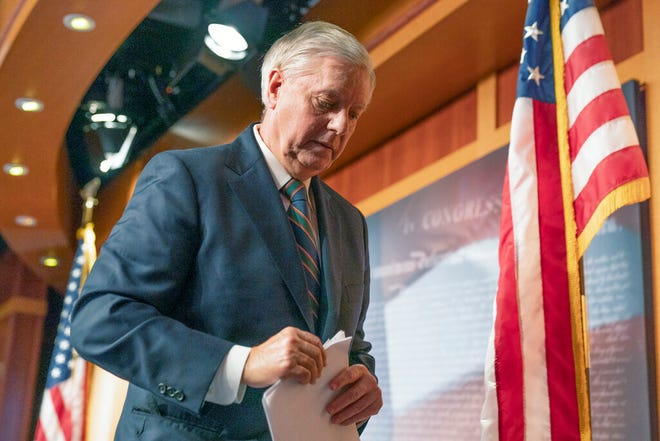 Sen. Lindsey Graham, R-S.C., walks off after speaking to reporters during a news conference at the Capitol, Thursday, Jan. 7, 2021, in Washington. Graham said Thursday that the president must accept his own role in the violence that occurred at the U.S. Capitol. (AP Photo/Manuel Balce Ceneta)