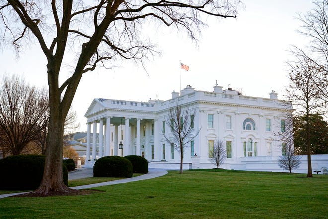 An American flag flies over the White House in Washington, Thursday, Jan. 7, 2021. (AP Photo/Patrick Semansky)