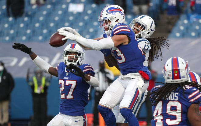 Bills safety Micah Hyde knocks down a Hail Mary pass in the end zone intended for Colts receiver T.Y. Hilton on the last play of 27-24 Buffalo win.