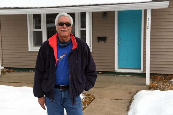 Moussa Nour stands in front of the house he is donating to Call for Freedom on Saturday, January 9, in Sioux Falls.