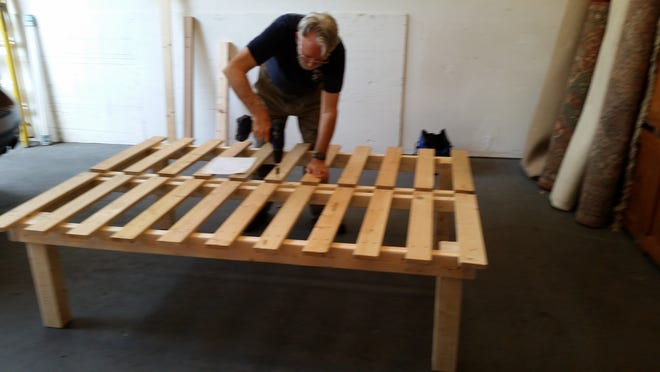 Bill Phelan constructs much of the furniture for the Furniture Bank.