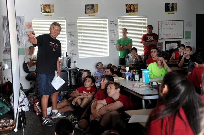 Ken Reeves goes over a training session with members of the Foothill Tech cross country team in 2014.