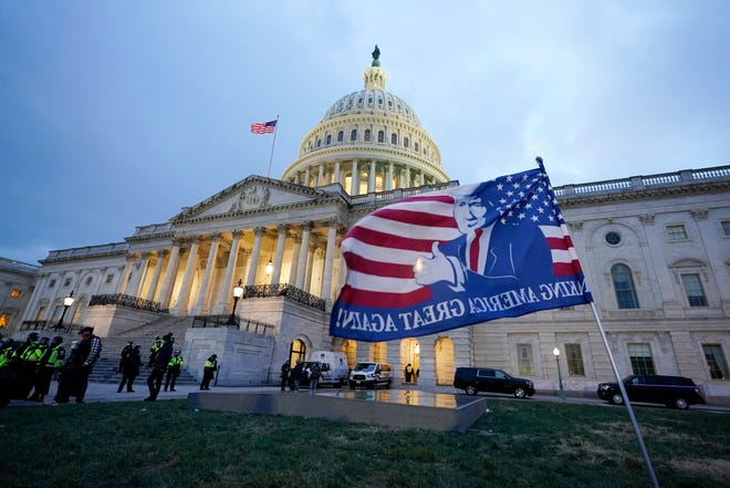 Trump supporters left a flag outside the Capitol, Wednesday evening, Jan. 6, 2021, in Washington.