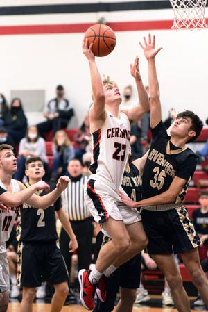 Caden Sparks goes in for a layup over River View's Owen Emig during host Crooksville's 67-54 win on Friday night in McLuney.