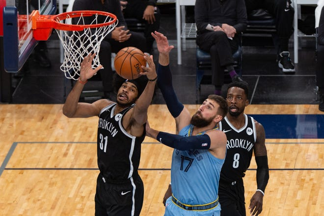 Brooklyn Nets center Jarrett Allen and Memphis Grizzlies center Jonas Valanciunas (17) fight for the ball during the first half of Friday night's game at the FedExForum.