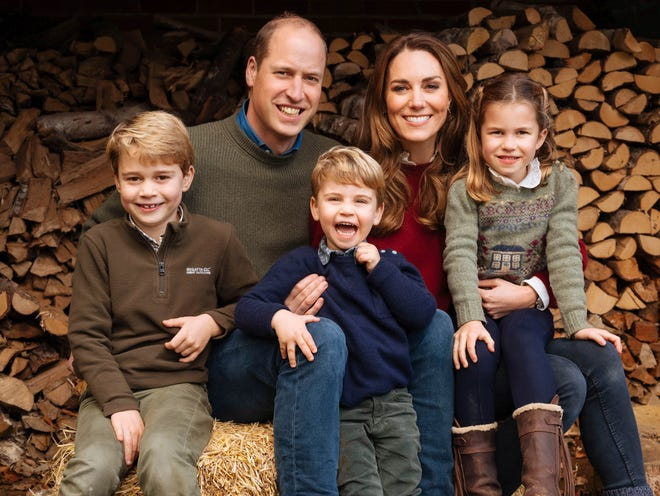 This autumn 2020 image provided by Kensington Palace on Wednesday Dec. 16, 2020, shows the 2020 Christmas card of Britain's Prince William, Kate, Duchess of Cambridge and their children, Prince George, left, Princess Charlotte and Prince Louis, center, at Anmer Hall, Anmer, England.