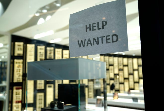 A Help Wanted sign is posted at a Designer Eyes store at Brickell City Centre, Friday, Nov. 6, 2020, in Miami.