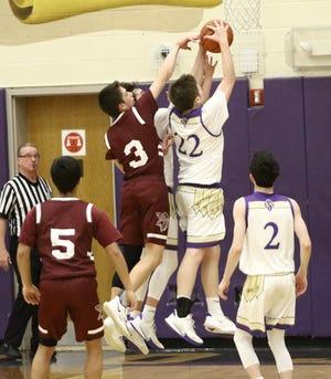 Sebring's Matt Byrd (22) and Dylan Johnson, back, and Waterloo's Gavin English (3) during action at Sebring McKinley High School Saturday, January 9, 2021.
