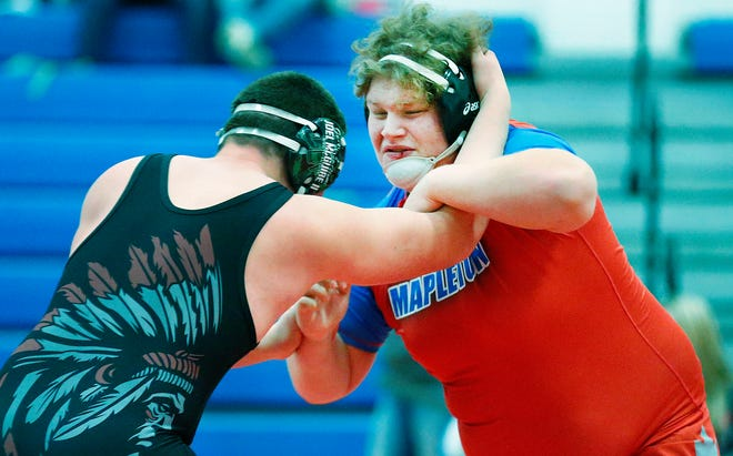 Mapleton's Joe Shoup grapples with Rittman's Tyler Thompson in their heavyweight match Saturday at the Mapleton New Year Invitational. Shoup won the match by pin.