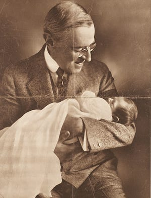President Woodrow Wilson, a former Augusta resident, admires his grandson, the last child born in the White House.
