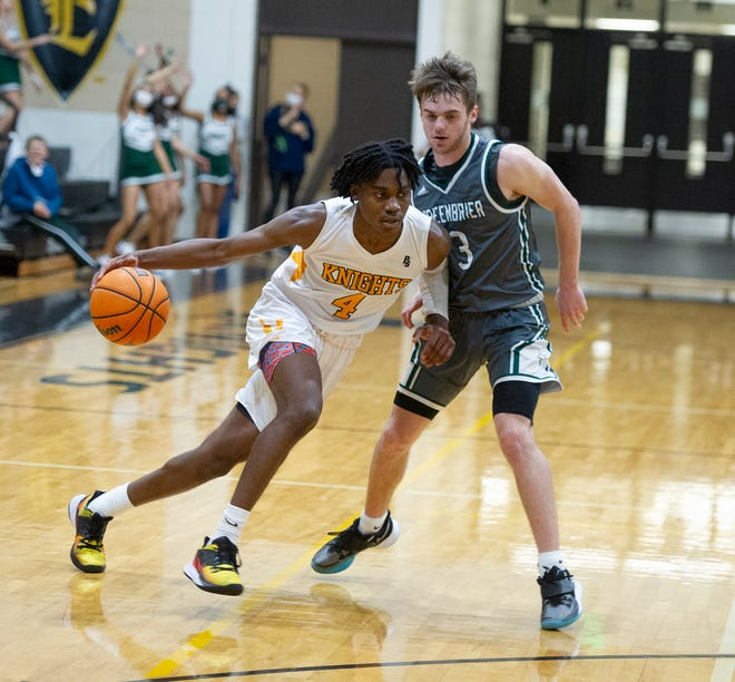 Evans' Rashad King (4) scored 17 points in the Knights' 67-64 win over Effingham County in Wednesday's Georgia High School Association Class 6A playoff opener.