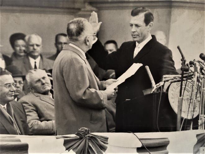 Carl Sanders takes the oath of office as Georgia governor in front of the state Capitol on Jan. 15, 1963.