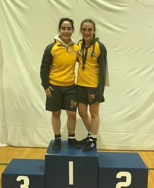 Delran's Emma Matera (left) and Kalli Roskos celebrate their South Region championships on the podium at Williamstown High School last winter. Both are eager to get back to work as they count down toward their junior seasons.