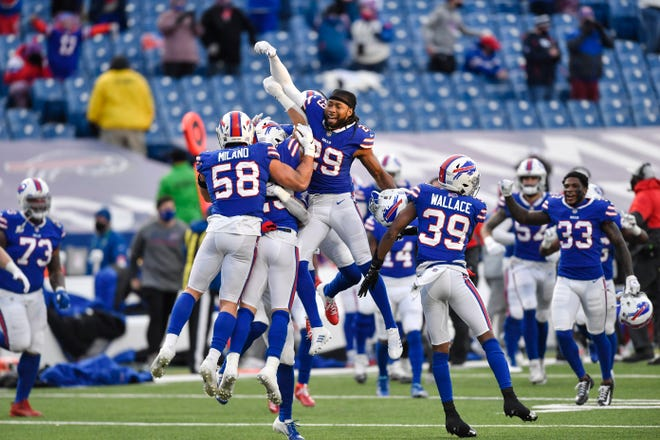The Bills celebrate their 27-24 win over the Indianapolis Colts in Saturday's wild-card playoff game in Orchard Park, N.Y.