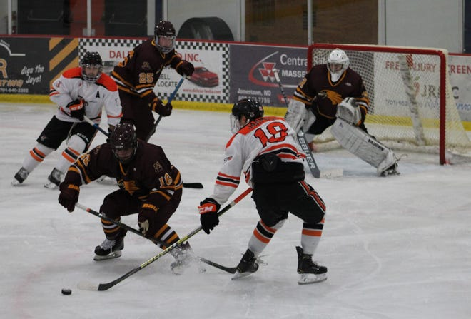 Casey Kallock (18) scored two goals as Minnesota Crookston won its first game as a revamped program, beating Jamestown 5-3.