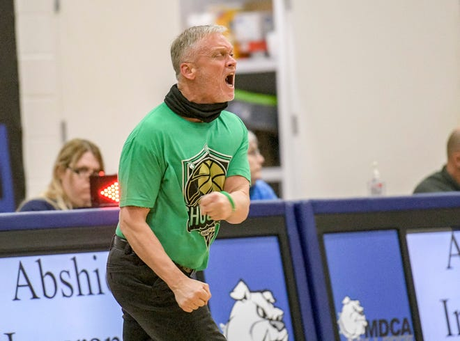 Mount Dora Christian Academy boys basketball coach Steven Hayes reacts to a play during Saturday's game Oviedo at the Nathan Hayes Shootout in MDCA's Brackett Gymnasium in Mount Dora. [PAUL RYAN / CORRESPONDENT]