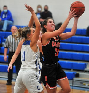 Dalton's Sarah Witmer puts a shot up against Chippewa's Ally Henegar.
