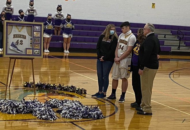 Keyser family members, including Jamestown basketball player Cam Keyser, stand on the court during a ceremony to honor his brother, the late Darian Keyser, whose No. 42 was retired, on Saturday, Jan. 9, 2021.