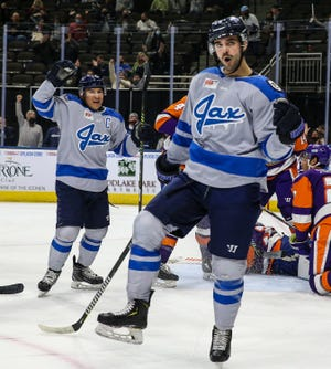 Jacksonville Icemen forward Wacey Rabbit (20), left, and forward Pascal Aquin (26) celebrate Aquin's goal during the second period of an ECHL hockey game against the Orlando Solar Bears at Veterans Memorial Arena in Jacksonville, Fla., Saturday, Jan. 9, 2021.  [Gary Lloyd McCullough/For the Jacksonville Icemen]