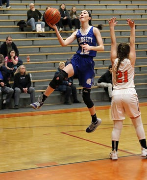 Narragansett forward Julie Davis (12), shown attacking the basket against Gardner's Becca Cormier in a game last year, returns to the Warriors for her junior season after leading the team in scoring (15 points per game) last winter.