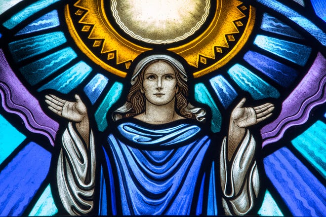 Detail from a stained-glass window at St. John of God Church in Somerset.