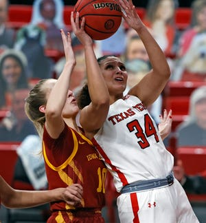Texas Tech's Lexi Gordon (34) shoots the ball over Iowa State guard Kylie Feuerbach (10) during the Lady Raiders' 99-72 loss Sunday at United Supermarkets Arena. Iowa State made a school record 19 3-point goals and dealt Tech its third Big 12 loss in a row.