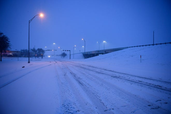 Several inches of snow accumulated on roads on Sunday, Jan. 10, 2021, in Lubbock, Texas. [Justin Rex/For A-J Media]