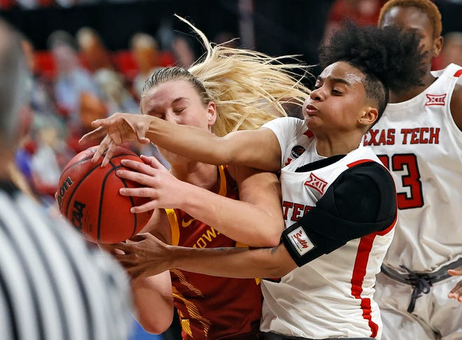 Iowa State's Madison Wise (1) and Texas Tech's Maka Jackson (3) rebound the ball during the second half of a Big 12 Conference game Jan. 10 at United Supermarkets Arena. The Lady Raiders lost 99-72.