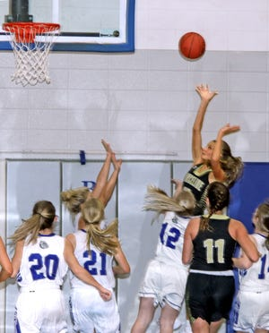 """Junior Ramzee Bruner of the Marceline High School basketball Lady Tigers hits a tough angle shot over multiple Brookfield defenders to give MHS a 5-2 lead in the first quarter of Friday's (Jan. 8, 2021) non-conference game at BHS. The 5'11"""" Lady Tiger rang up a game-high 22 points, including converting 12 of 17 free throws, to lead MHS to a 47-29 triumph."""