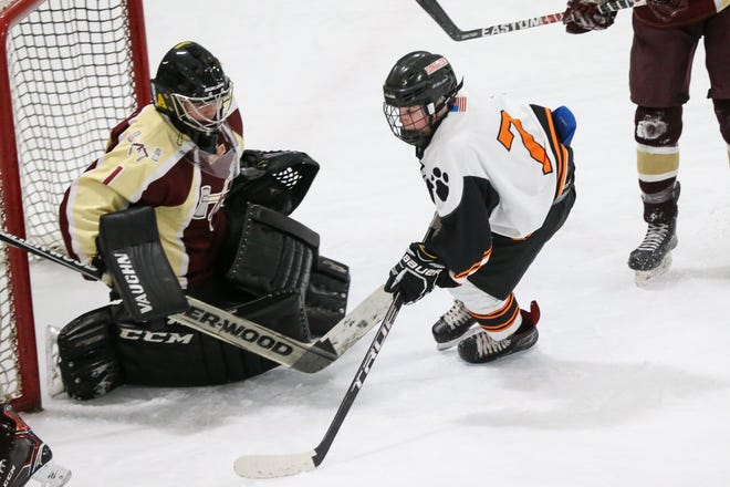Marlborough's Marcus Chrisafideis tries to sneak one past former Algonquin goalie Matthew Bogdanski during the second game of the 18th annual Daily News Cup at New England Sports Center in Marlborough on Dec. 27, 2017. On Saturday, Chrisafideis scored a goal in the Panthers' season-opening win over Algonquin.