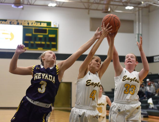 Nevada's Sydney Mosinski battles Saydel's Vanessa Garton (4) and Josie Ranck for a rebound during the Cubs' 60-27 victory over the Eagles Jan. 4 at Saydel High School in Des Moines. Mosinski had 15 points, eight rebounds and three blocks in the win.