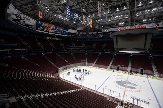 Vancouver Canucks players participate in the team's training camp Jan. 8 in Vancouver, British Columbia. The team called off its practice Sunday due to potential exposure to COVID-19.