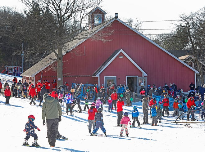 Local skiers flock to the Blue Hills Ski Area in Canton on Sunday, Jan. 10.