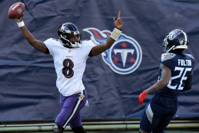 Baltimore Ravens quarterback Lamar Jackson (8), a former Boynton Beach High standout, celebrates after scoring a touchdown on a 48-yard run against the Titans in Sunday's wild-card game.