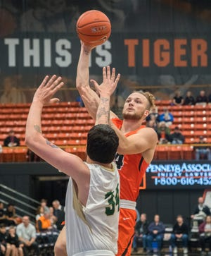 Pacific's Broc Finstuen, left, shoots over Pacific Union College's John Nalty during the men's basketball home opener Nov. 14, 2019, at Spanos Center in Stockton.