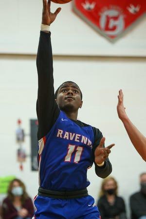 Ravenna senior Jorim McElrath puts up a lay-up during Saturday night's game against Crestwood High School.