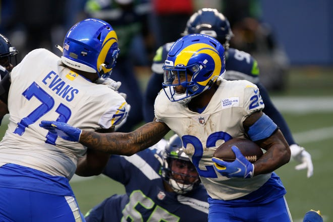 Los Angeles Rams running back Cam Akers set a rookie team record with 131 rushing yards in Saturday's 30-20 wild-card win over Seattle.
