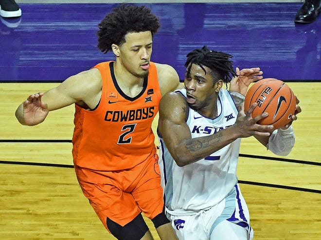 Kansas State guard Selton Miguel, right, works against Oklahoma State's Cade Cunningham during Saturday's game at Bramlage Coliseum.