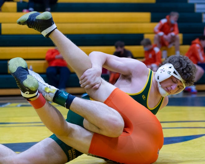 Salina South's Brandon Jeffries looks to pin Colby's Colin Carroll from Colby during the South Invitational Saturday at the South gym.