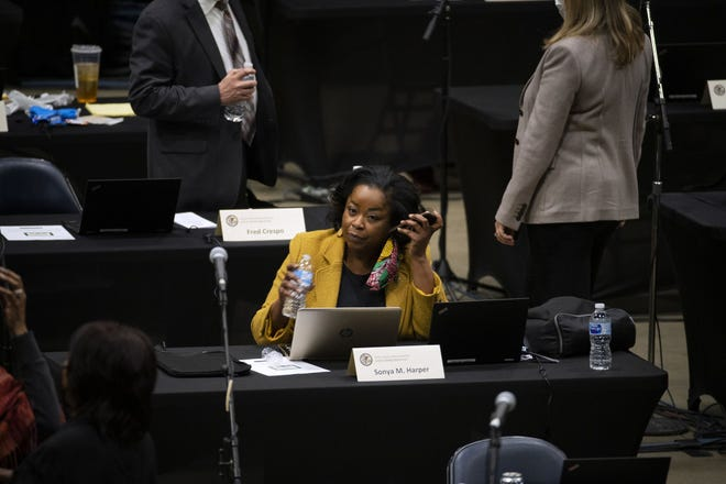 Rep. Sonya Harper, D-Chicago, recently elected chair of the joint Illinois Legislative Black Caucus, works on the floor as the House of Representatives convenes at the Bank of Springfield Center on Jan. 8, 2021.